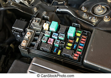 fuse box - Detail of a car engine bay with fuses