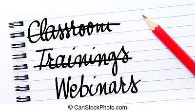 Webinars written on notebook page with red pencil on the...