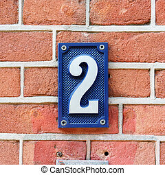 Number 2 - House number two on a red brick wall