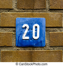number 20 - House number twenty White numerals on a blue...