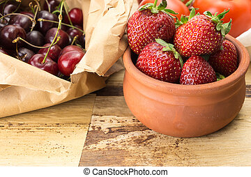 Fresh fruits and vegetables on wooden surface