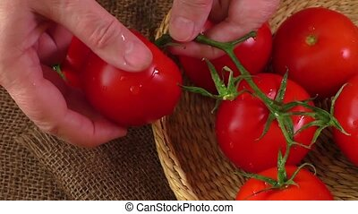 Ripe red tomatoes on a background of burlap