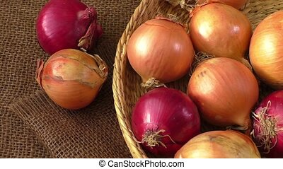 Various onions on a background sacking, burlap