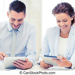 business team working with tablet pcs in office - smiling...