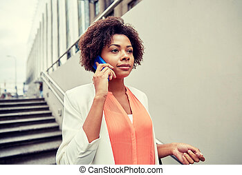 african businesswoman calling on smartphone - business,...