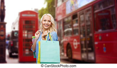woman with shopping bags over london city street - people,...