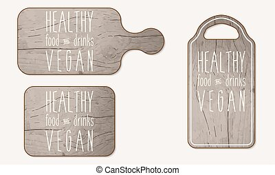 Wooden breadboard with the words healthy, food, drinks;...