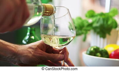 White Wine Being Poured - A close up shot of someone pouring...