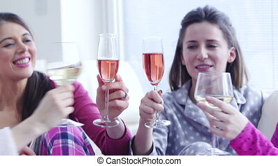 Ladies Celebrating At Home - Four women are sat in their...