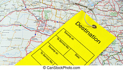 Luggage tag on open map - A yellow luggage tag sitting on a...