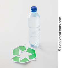 close up of plastic bottle and recycling symbol