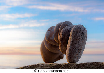 Stones on sea background - Balancing of pebbles on sea...