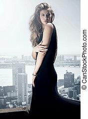 Stylish elegant woman posing in evening dress. - Stylish...
