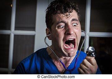 Yelling Crazy Nurse - Crazy lunatic male nurse yells into...
