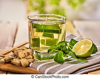 Glass with green mint lime drink and ginger . - Healthy...
