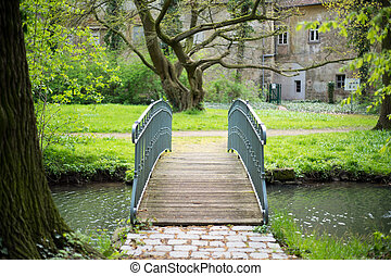 wooden footbridge - old wooden footbridge over a pond