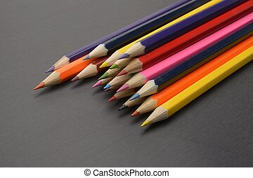 Colour pencils isolated on black background