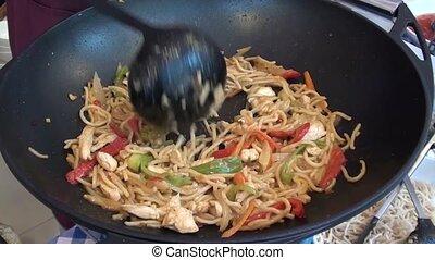 Stirring Chinese pasta
