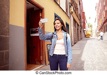 Cute young girl taking pictures with cell phone - Sweet...