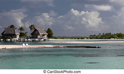 Typical Polynesian landscape - island with palm trees and...