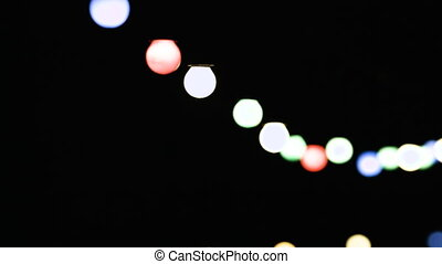 Decorative outdoor string lights hanging at night time