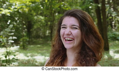 Young beautiful girl laughing in the park