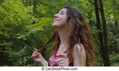 Happy young woman relaxing in the park