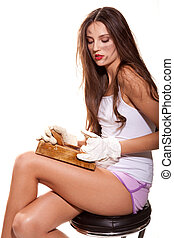 woman jointer - young woman sharpens her legs with wooden...