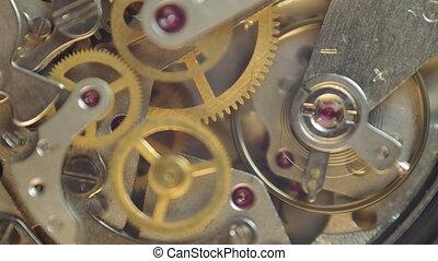 Metal cogwheels inside clockwork chronograph Concept...