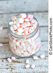 One glass jar filled up with marshmallow