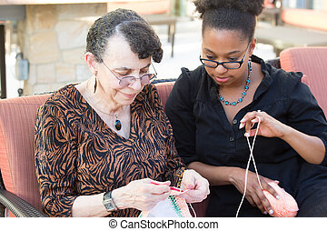 Sewing together - Closeup portrait, granddaughter and...