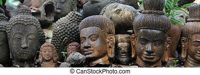 buddah -  a line of Buddah heads