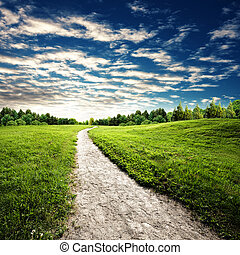 Hiking and travel backgrounds with park lane and beauty hills under wide sky