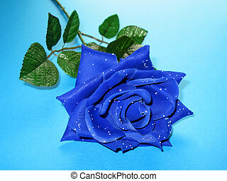 Blue Rose 1 - An artificial blue rose with dewy petals on a...