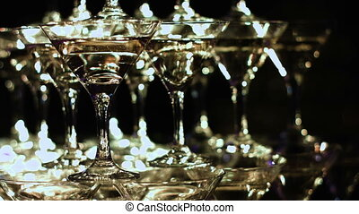 Celebration. Pyramid of champagne glasses. Gently toned.