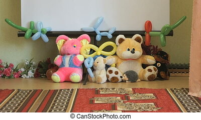 The baby soft animal toys in the hall of a nursery