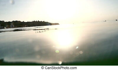 in water sunset slow motion