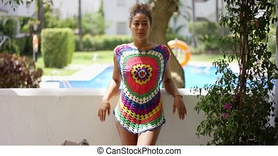 Beautiful woman in colorful knit top on balcony - Single...