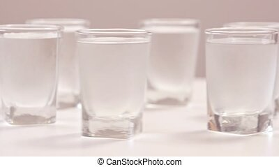 Cold vodka rotating on the table - Vodka on the table Party