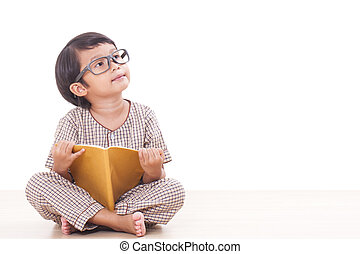 Cute boy is reading a book