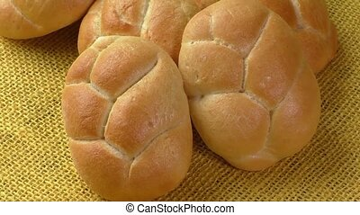Fresh wheat buns on the sacking background