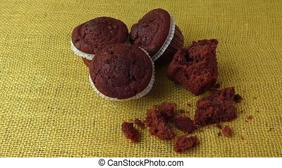 Chocolate pastry muffins on a rustic background