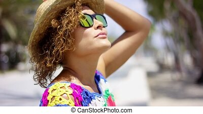 Pretty woman in sunglasses and hat outside - Pretty adult...
