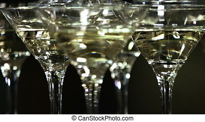 Martini glasses in the form of a cascade or pyramid lit...