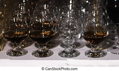 Glasses with cognac or brandy. Alcohol drink background