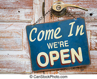 Come In Were Open on the wooden door, retro vintage style