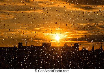 rain drops on  window st sunset sky