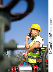 Oil worker using smart phone