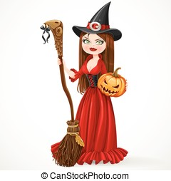 Beautiful witch in a red dress holding a broom for flying...