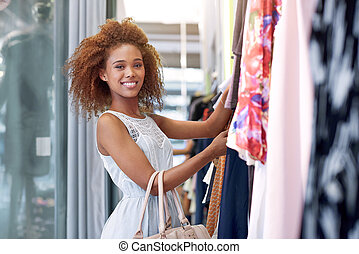 Finding that perfect outfit - Portrait of an attractive...
